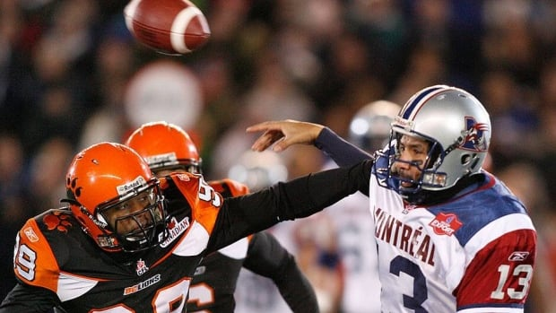 The Lions' Chris Wilson, left, is seen rushing Alouettes quarterback Anthony Calvillo during the 2006 Grey Cup. Wilson, who has signed a free-agent deal with B.C., has spent five of the past six seasons in the NFL with Washington.
