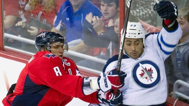 Capitals left-winger Alex Ovechkin, left, and his club will be taking on Dustin Byfuglien's  Jets on Saturday in the Kraft Hockeyville contest.
