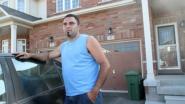 """Patrick Araya moved to Waterdown a year ago in search of a small town atmosphere. """"What we have here, there's no possibility of getting it Brampton,"""" he said of his two-storey semi-detached home. Waterdown's population is expected to double in the next five years from new developments."""