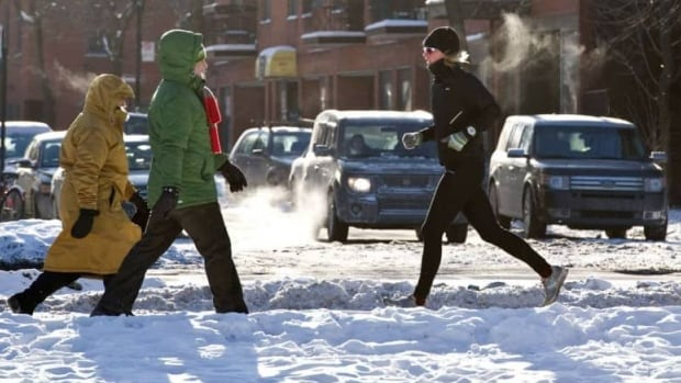 A runner braves -20 C temperatures in Montreal on Jan. 23. Lyndon Smith recommends covering your face to keep active outside in cold weather.