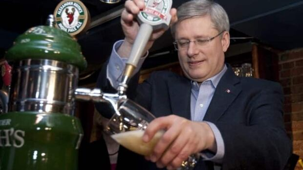 Conservative Leader Stephen Harper pours a beer at Halifax's Red Stag Tavern. New measures in the federal budget are expected to help Alberta brewers be more creative. (Adrian Wyld/CP)
