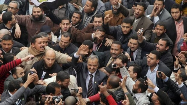 Following a military coup in July that ousted the democratically elected Muslim Brotherhood from power, Egyptian authorities have increasingly cracked down on the group. Top leaders including Mohammed Beltagi, seen here at centre being cheered by supporters, have been arrested. (Kahled Desouki/AFP/Getty)