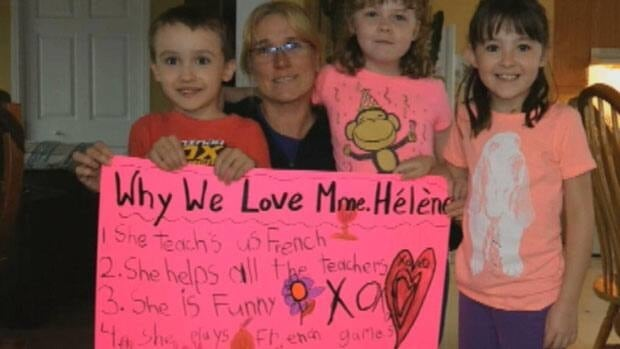 Some students in western Labrador have made a sign in support of their French immersion teacher's aide.