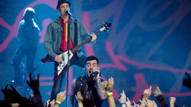 Jacob Hoggard and Tommy Mac of Hedley perform in 2012 in Ottawa. The band cancelled a show in Winnipeg on April 1 due to bad weather and road closures.