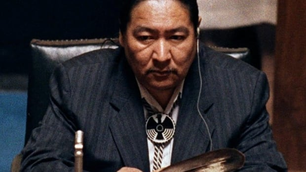 Aboriginal leader Elijah Harper, a former Manitoba MLA and MP, played a key role in defeating the Meech Lake accord. Here, Harper holds an eagle feather for spiritual strength as he refused to support the accord in Winnipeg in 1990.