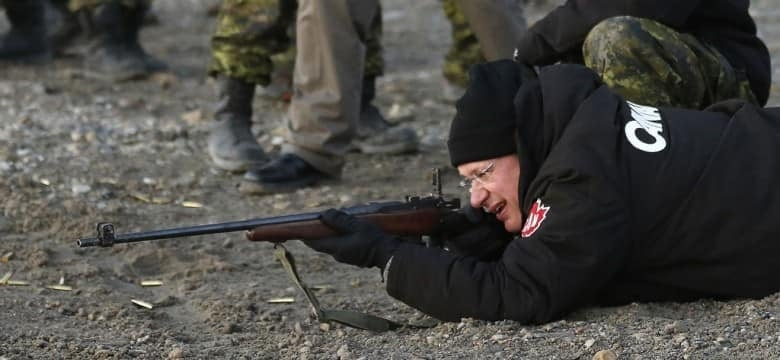 Former prime minister Stephen Harper, shown here firing a .303 Lee Enfield rifle while participating in a Canadian Ranger demonstration in Nunavut in 2013, pushed for Arctic sovereignty. But his efforts were viewed by the United States as merely a bid for votes, according to a WikiLeaks cable. (Chris Wattie/Reuters)