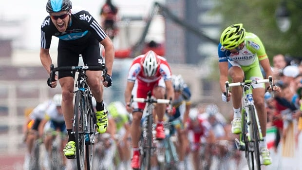 Lars Petter Nordhaug of Norway, left, crosses the finish line ahead of Moreno Moser and Alexandr Kolobnev to win the Grand Prix Cycliste de Montreal race in Montreal Sunday, September 9, 2012.