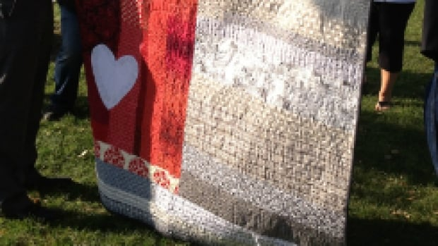 Calgary quilters went door-to-door Saturday to deliver handmade quilts to neighbourhoods hardest-hit by June's floods.