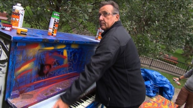 Richard Leblond, the tuner and maintenance man for the Montreal public pianos project, gets ready to sit down and play a piano that was badly damaged by fire and graffiti.