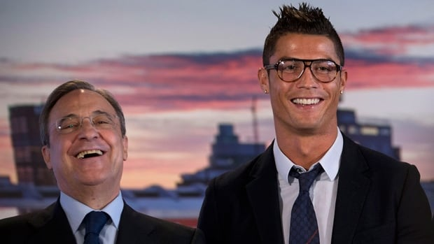 Real Madrid's Cristiano Ronaldo, right, and club president Florentino Perez during a presentation at the Santiago Bernabeu stadium in Madrid, Spain Sunday Sept. 15, 2013.