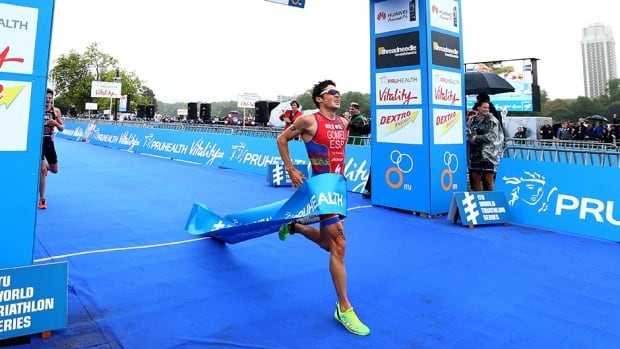 Javier Gomez of Spain crosses the line to win the world triathlon Grand Final on September 15, 2013 in London, England.