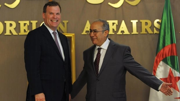 Foreign Affairs Minister John Baird, shown with his Algerian counterpart Ramtane Lamamra,  said he's encouraged by the changes SNC-Lavalin has made.