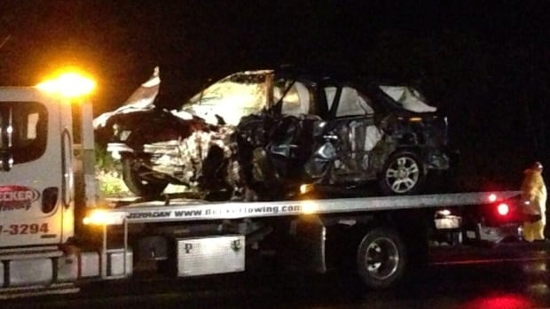 Crews remove a vehicle that was involved in a dramatic collision on the Trans-Canada Highway on Sunday.