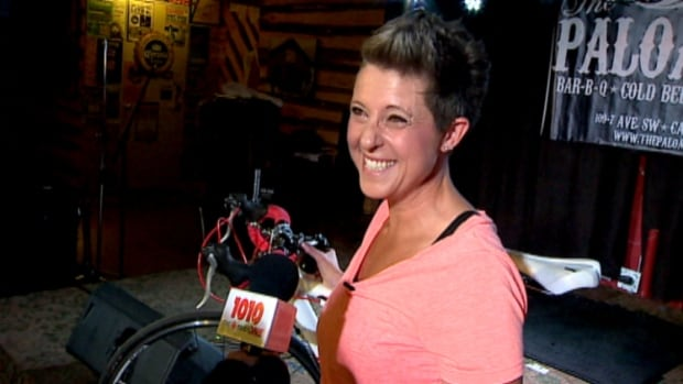 Donna Chizen gets her stolen bike back at the Palomino Club in Calgary after two employees there spotted it and retrieved it.
