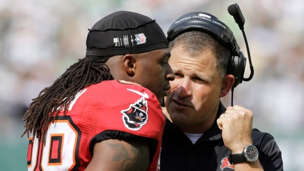Tampa Bay Buccaneers coach Greg Schiano, right, talks during a game last week to free safety Dashon Goldson, who was suspended for a game by the NFL on Monday.