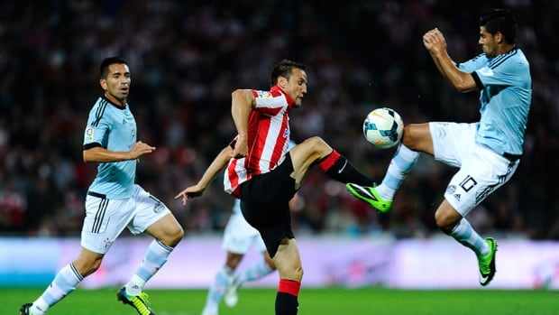 Carlos Gurpegi of Athletic Club, centre, duels for the ball with Manuel Agudo 'Nolito' of RC Celta de Vigo during their match at San Mames Stadium on Monday in Bilbao, Spain.