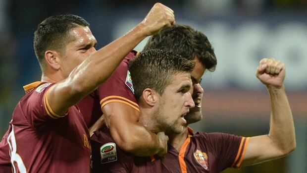 Kevin Strootman of AS Roma, centre, celebrates scoring his club's third goal against Parma FC at Stadio Ennio Tardini on Monday in Parma, Italy.