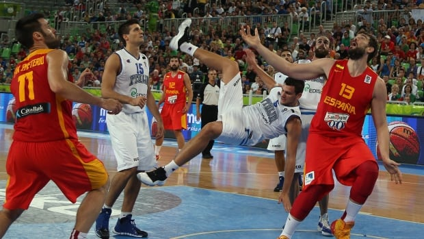 Italy's Alessandro Gentile, centre, falls as he tries to stop Spain's Marc Gasol, right, during their EuroBasket Group F match at the Stozice Arena, in Ljubljana, Slovenia, on Monday.