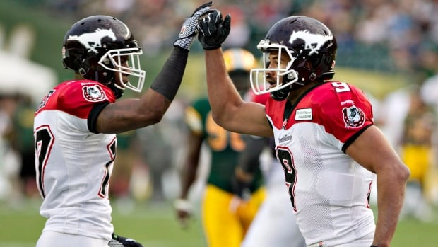 Maurice Price, left, and Jon Cornish of the Calgary Stampeders have helped propel their squad to top spot in the CFL this season.