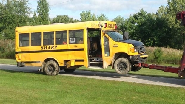 The driver of a school bus had to be extricated and taken to hospital Tuesday morning.
