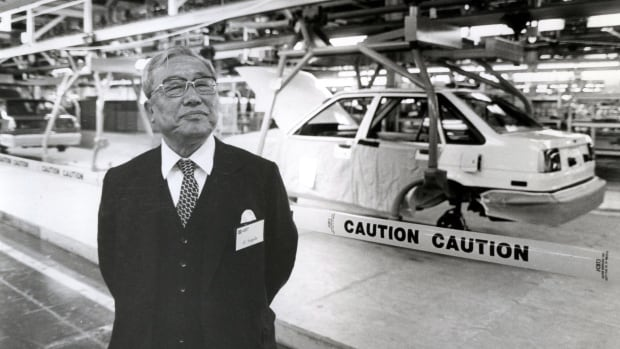 Eiji Toyoda stands in front of a Chevrolet Nova on the assembly line at the New United Motor Manufacturing Inc., or NUMMI, plant in Fremont, Calif., in April 1985. Toyoda, as chairman of the Japanese automaker Toyota helped set up the plant, a partnership with General Motors Co.