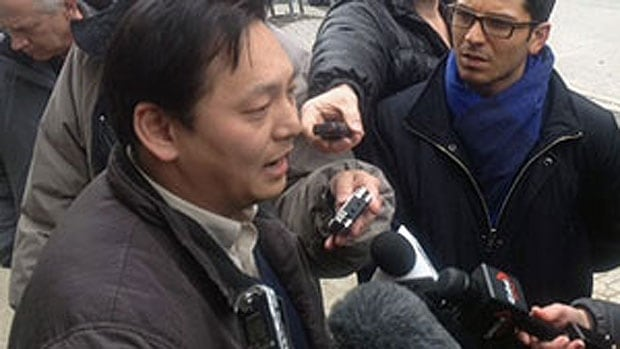 Joe Chan speaks reporters outside the Winnipeg courthouse on April 5, 2013.