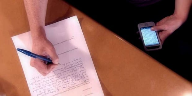 student-cheating-smartphone-paper