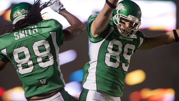 Saskatchewan Roughriders wide receiver Taj Smith celebrates Saskatchewan Roughriders slotback Chris Getzlaf's touchdown against the Toronto Argonauts during the second quarter of CFL football action in Regina, Sask., Saturday, September 14, 2013.