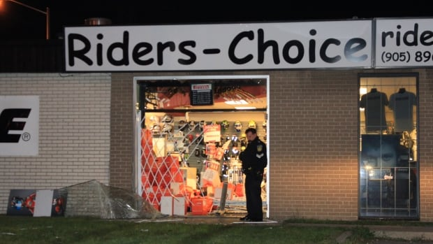 "Five men face charges in connection with a series of so-called ""smash-and-grab"" robberies that occurred in Toronto and Peel Region between Aug. 30 and Sept. 18. The Riders Choice store in Mississauga, shown above, was among the businesses that were hit."