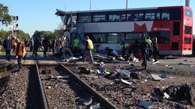The September crash of an OC Transpo bus and a Via passenger train killed six people and prompted a Transportation Safety Board investigation. (Terry Pedwell/Canadian Press)