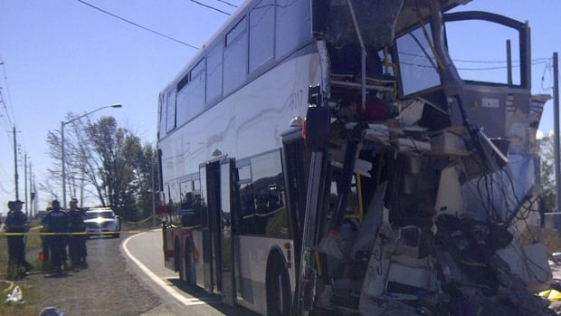 The driver of this double-decker bus, operated by OC Transpo, was among six people killed in a crash. The bus, destined for downtown Ottawa, was travelling north on the Transitway when it collided with a Toronto-bound Via Rail train on Sept. 18, 2013. (TSB Canada/Flickr)