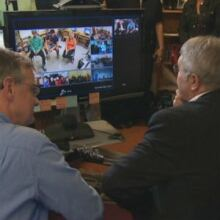 Education minister Clyde Jackman participates in distance education class