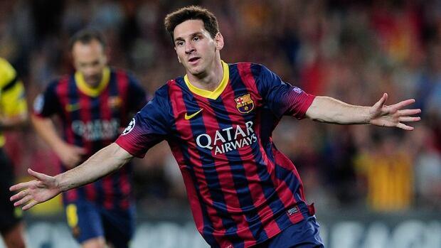 Barcelona's Lionel Messi celebrates after scoring against Ajax Amsterdam at Camp Nou stadium in Barcelona on September 18, 2013.