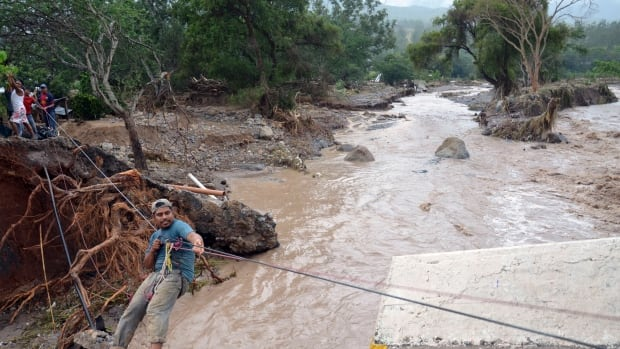 The toll from devastating twin storms in Mexico climbed to 80 on Wednesday as isolated areas reported deaths and damage to the outside world, and Mexican officials said that a massive landslide in the mountains north of Acapulco could drive the number of confirmed dead even higher. (Alejandrino Gonzalez/Associated Press)