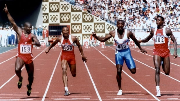 Canada's Ben Johnson, left, signals victory as he wins the men's 100-metres at the 1988 Seoul Olympics on Sept. 24, 1988.