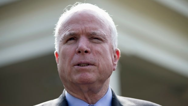 Senator John McCain speaks with reporters outside the White House in on Sept. 2, 2013. McCain has criticized Russian President Vladimir Putin in an op-ed piece published on a Russian website.