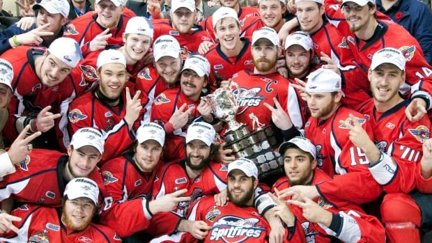The Windsor Spitfires pose with the Memorial Cup after defeating the Brandon Wheat Kings  in Brandon, Manitoba on May 23, 2010. Frank Gunn/Canadian Press