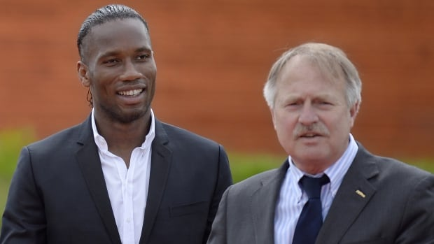 Secretary general of the FIFPro group of European soccer unions, Theo van Seggelen, right, said that the policy advisory body has refused to agree to switch the 2022 World Cup in Qatar from summer to winter before a detailed consultation with FIFA. FIFPro represents clubs, leagues and players, including star Didier Drogba, left.