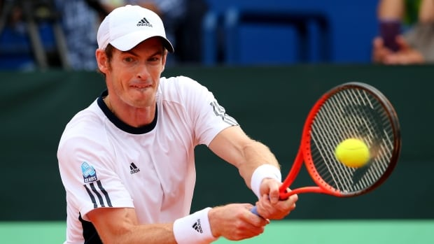 Andy Murray of Great Britain, seen here in action against Ivan Dodig of Croatia during day three of the Davis Cup World Group play-off tie between Croatia and Great Britain on September 15, is out for the rest of the season with a back injury.