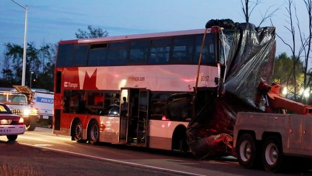 Six passengers were killed when this double-decker route 76 OC Transpo bus collided with a Via Rail train in Barrhaven on Sept. 18, 2013. (Fred Chartrand/The Canadian Press)