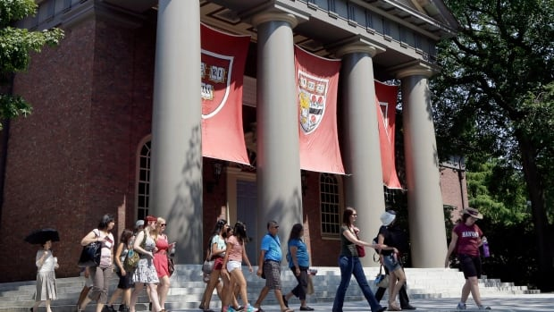 Students tour the Harvard University campus. A New York consulting firm helps Canadian students, and students from around the world, get into U.S. universities.