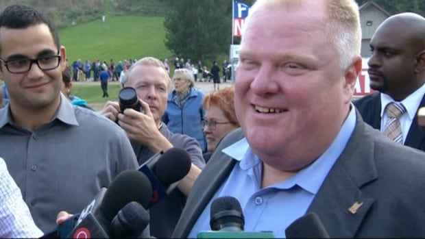Toronto Mayor Rob Ford speaks to reporters Friday at his annual Ford Fest community barbecue in Etobicoke. He said he was expecting 20,000 people to attend the free event.