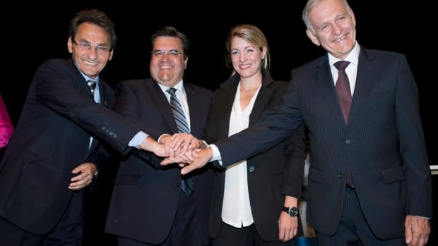 Municipal elections candidates wrapped up their campaigns today ahead of Sunday's vote. From left, Montreal mayoralty candidates Richard Bergeron, Denis Coderre, Mélanie Joly and Marcel Côté greet each other prior to the first debate in Montreal, Friday, August 16, 2013.