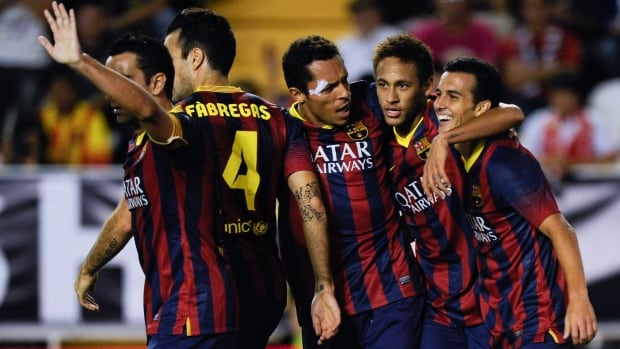 Pedro Rodriguez, right, of FC Barcelona celebrates with his teammates after scoring his third goal of the game during the La Liga match between Rayo Vallecano de Madrid and FC Barcelona at Estadio Teresa Rivero on Saturday in Madrid, Spain.