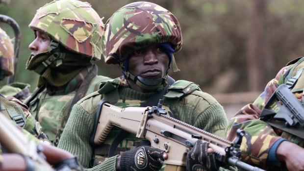 A soldier from the Kenya Defence Forces arrives at the Westgate Shopping Centre in Nairobi. Kenyan security forces are locked in a stand-off with gunmen in the upmarket mall.