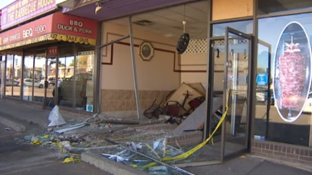 A car plowed into the front of New York Pizza and Donair at 97th Street and 118th Avenue Sunday morning.