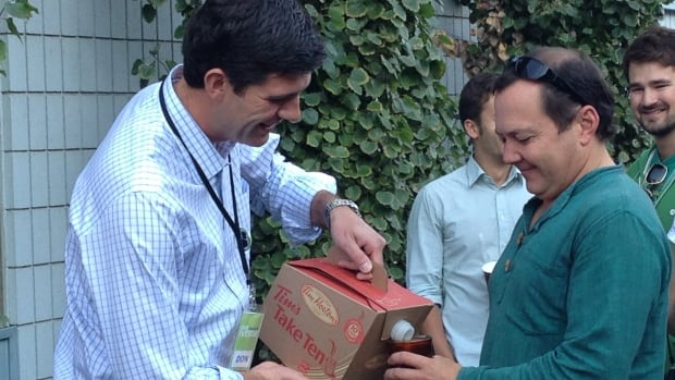 Mayoral candidate Don Iveson, 34, pours coffee for one of his campaign volunteers.