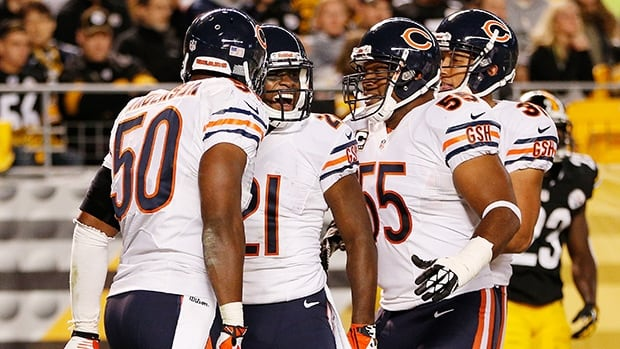 Chicago Bears players celebrate a touchdown against the Pittsburgh Steelers at Heinz Field on September 22, 2013 in Pittsburgh, Pennsylvania.