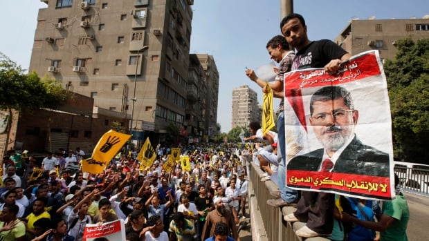 Supporters of the Muslim Brotherhood chant slogans earlier this month. An Egyptian court has banned the Muslim Brotherhood group and ordered its assets confiscated.