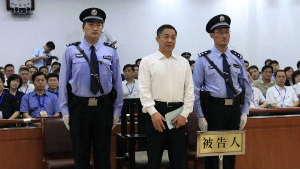 Disgraced former Communist Party strongman Bo Xilai stands in the Jinan Intermediate People's Court on Sunday, when he was convicted of corruption and sentenced to life in prison.